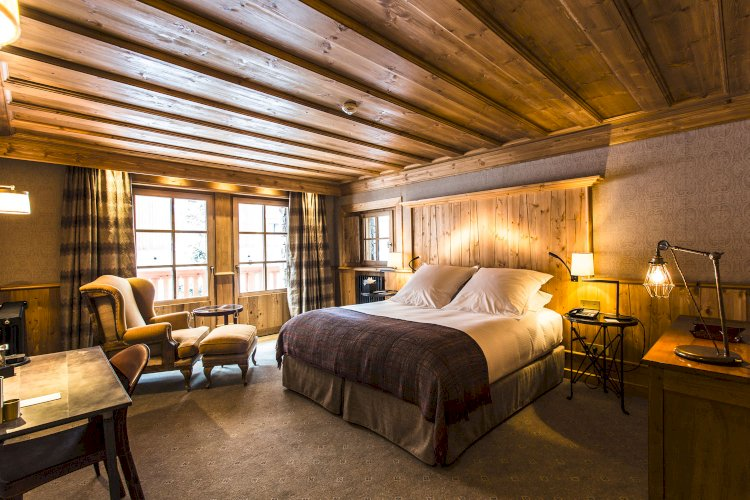 Industrial lighting helps create a home away home in this Alpine mountain hotel