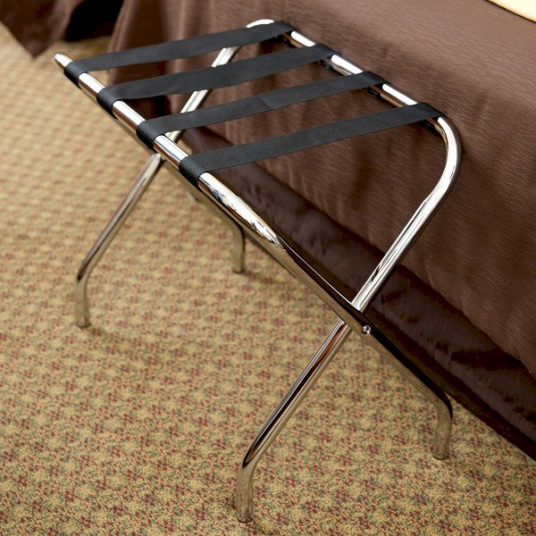 A chrome luggage rack from Lancaster Table & Seating is the perfect place for guests to store their luggage and travel bags.